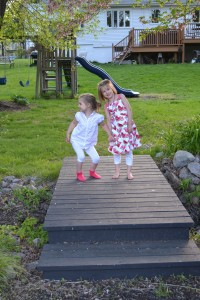 bridge between two back yards, with girls lauging