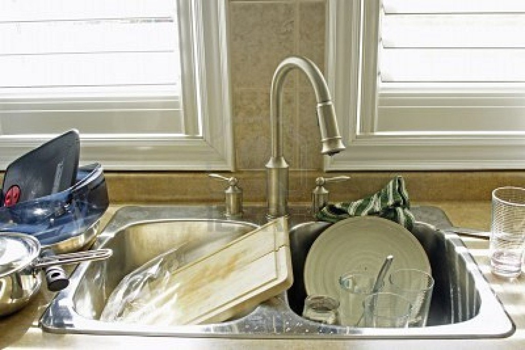 Kitchen Sink With Dishes when a host family takes advantage of 'pitching in'